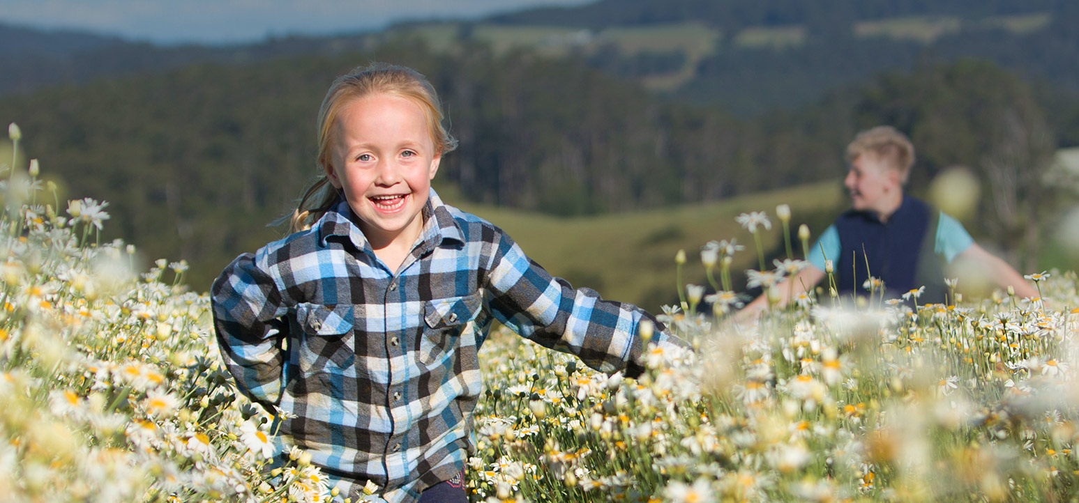 header - child running through flowers